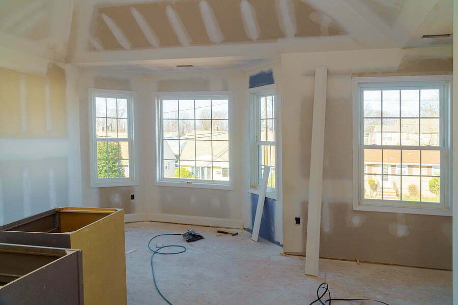 painting applied interior construction of housing with drywall installed and patched